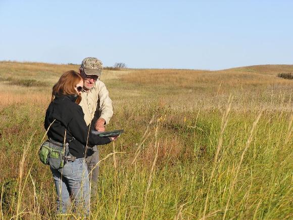 R Cressey and Harold Kantrud examine plants at Mt Moriah WPA
