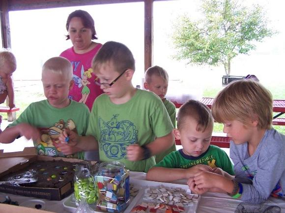 Community Members Make Stepping Stones at Day Camp